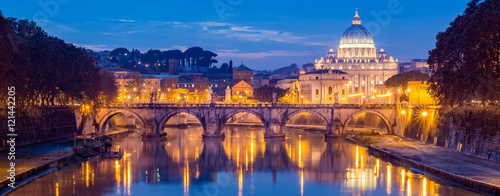 Photo Stands Rome Vatican City, Rome, Italy, Beautiful Vibrant Night image Panorama of St. Peter's Basilica, Ponte Sant Angelo and Tiber River at Dusk in Summer. Reflection of The Papal Basilica of St. Peter