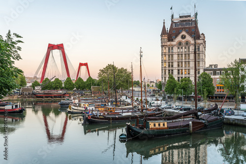 Staande foto Rotterdam Rotterdam City, Oude Haven oldest part of the harbour, historic ship yard dock, Old Ship, Openlucht Binnenvaart Museum, Haringvliet and the Willemsbrug bridge at Dusk in Summer, Netherlands
