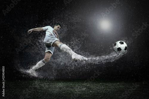 Fotografie, Tablou  Splash of drops around football player under water