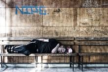Homeless Man Sleeping On The W...