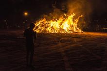 Boy On A Bonfire On A Beach At...
