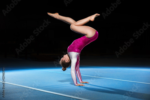 Poster de jardin Gymnastique portrait of young gymnasts competing in the stadium