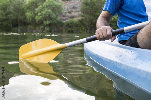 Spain, Segovia, Hand of a man in a canoe