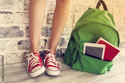 Obraz Student girl legs with backpack - fototapety do salonu
