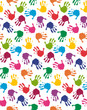Seamless pattern with colorful baby hands
