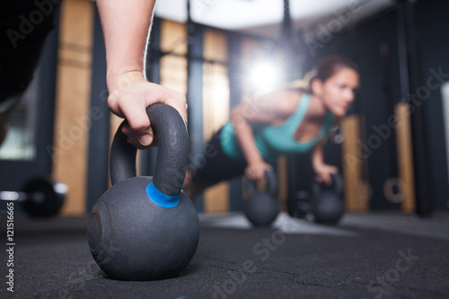 pushups on kettlebell at functional fitness  gym