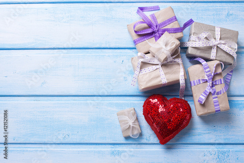 Many festive gift boxes with presents and red decorative heart