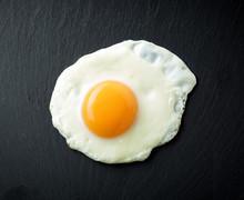 Fried Egg On Black Background