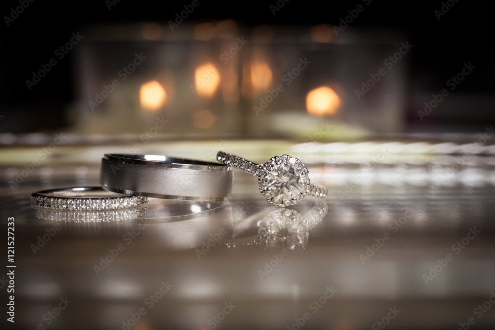 Fototapety, obrazy: Wedding rings stacked on beautiful background