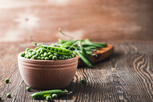 Green Peas In Wooden Bowl On  ...