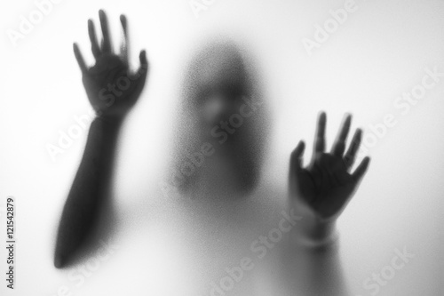 Fotografie, Obraz  Horror woman behind the matte glass in black and white. Blurry h