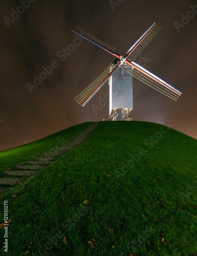 Cornmill in Bruges by night in Bruges, Belgium Canvas Print