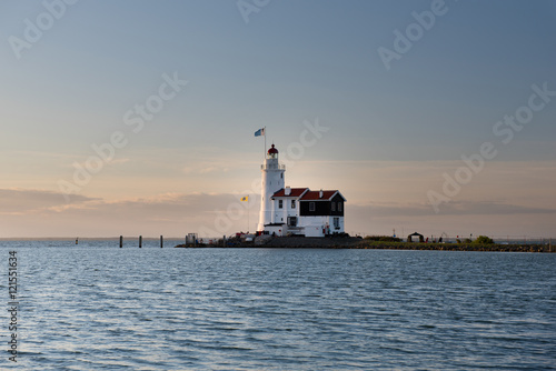 Canvas Prints Horses White Horse lighthouse of Marken at sunrise, The Netherlands