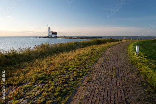 Fotobehang Paarden White Horse lighthouse of Marken at sunrise, The Netherlands