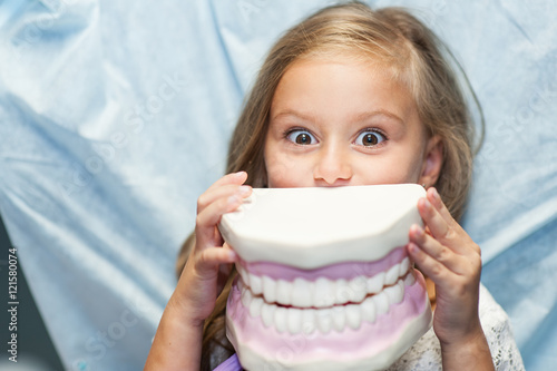 Fotografie, Obraz  Dentist curing a child patient in the dental office in a pleasant environment