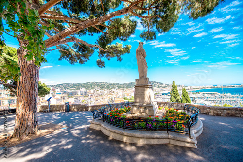 Fotografie, Obraz Beautiful park with cityscape view on Cannes city on the french riviera