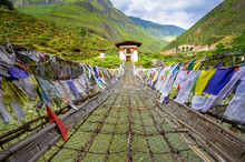 Walking Suspension Bridge With A Lot Of Colorful Prayer Flags In Bhutan