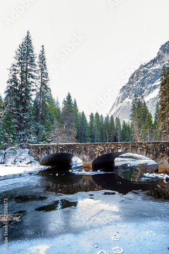Snowy winter scene on a road with Half Dome in the background in Yosemite Nation Canvas Print