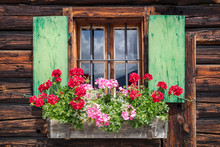 Window Of An Old Wooden Cabin In The Alps