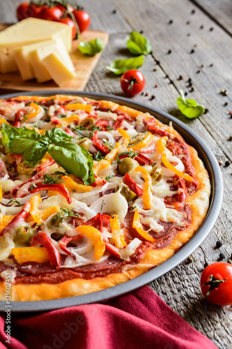 Fototapety, obrazy: Salami pizza with green olives, pepper, onion and Edam cheese