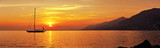 Fototapeta Sunset - Panoramic view of Sailing at sunset with mountains