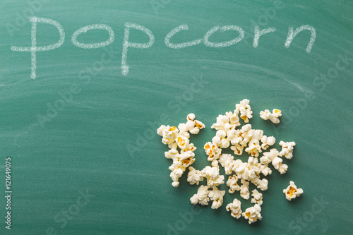 Popcorn on green chalkboard.