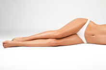 Long Woman Legs Isolated On Wh...