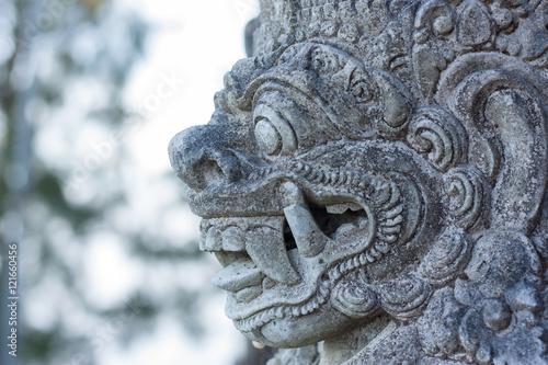 Tuinposter Indonesië Stone Balinese sculpture. Bali island, Indonesia.