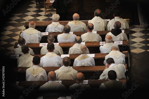 Priests sitting in church. Fototapeta