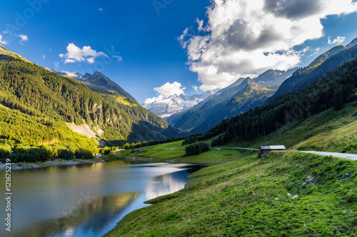 Plakat Colorful summer morning on the Speicher Durlassboden lake. View of Richterspitze mountain range in the Austrian Alps. Austria, Europe.
