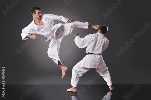 Obrazy Karate   two-handsome-young-male-karate-fighting-on-the-gray-background