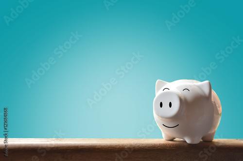 Fotomural  Piggy bank on blur background. Soft focus