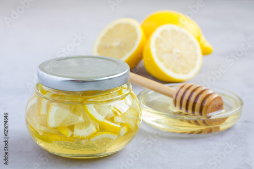 Photo  Lemon and honey mix in glass jar, copy space