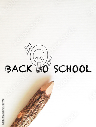 Fotografie, Obraz  concept idea for back to school wording and light bulb on white note paper with