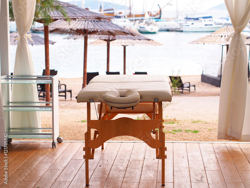 Photo sur Toile Drawn Street cafe Massage table by the beach