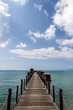 Old wood bridge pier and blue sky, Andaman Sea, thailand