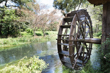 Ancient Water Wheel Within Serene And Scenic River