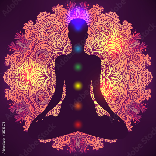 Photo  Woman ornate silhouette sitting in lotus pose. Meditation, aura