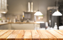 Wood Table Top On Light Abstract From Kitchen Room Background.