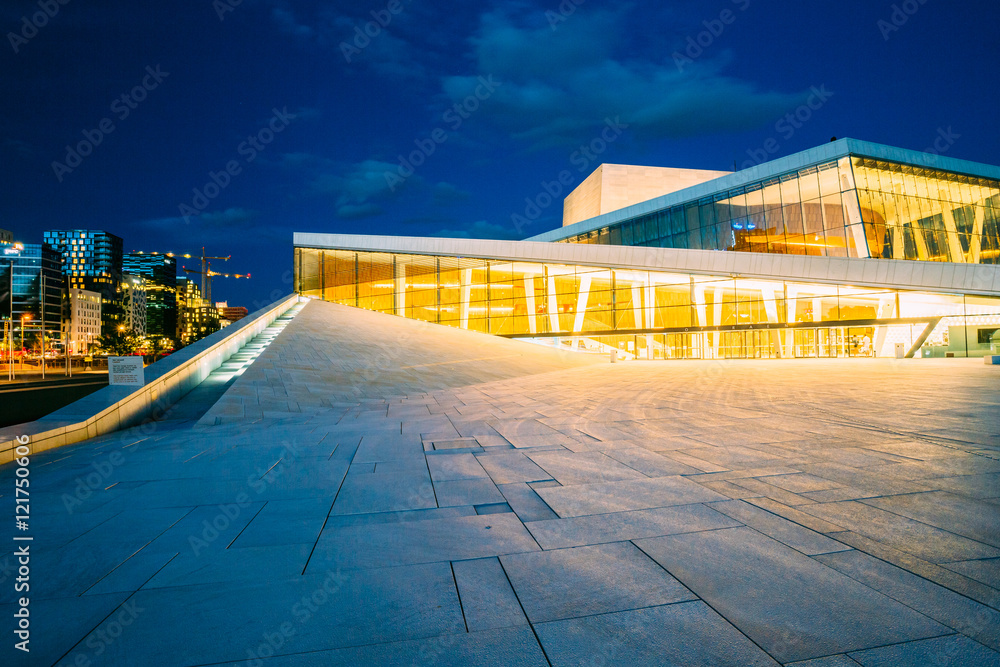 Fotografie, Tablou  Oslo, Norway. Side View Of Brightly Illuminated Facade Of Opera