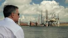 Man Looking At Oil Platform In...