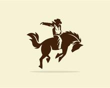 Cowboy Riding Wild Horse