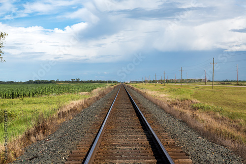 Fotografie, Obraz  Railroad tracks in North Dakota on a summer day.