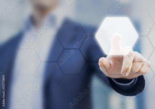 Fotografía  Person touching an hexagonal button on a digital interface