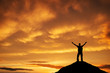 Silhouette of a man on a mountain top against the sunset sky. Sp