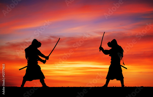 Silhouette of samurais in duel. Picture with two samurais and su Wallpaper Mural