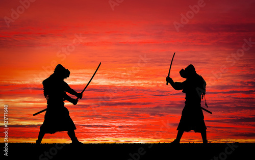 Silhouette of samurais in duel. Canvas Print