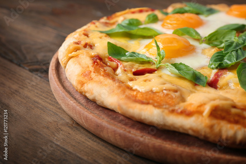 Fotografia, Obraz  Margarita pizza with basil leaves and egg on wooden background