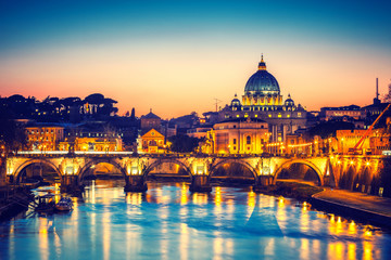 Fototapeta Rzym Night view of St. Peter's cathedral and Tiber river in Rome, Italy