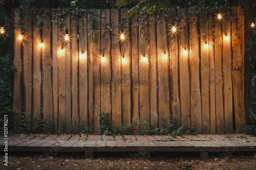 Fotografiet  Wooden Stage In The Garden